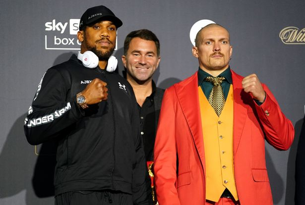 Anthony Joshua (left) and Oleksandr Usyk with Chairman of Matchroom Boxing Eddie Hearn during a press conference at the Tottenham Hotspur Stadium, London
