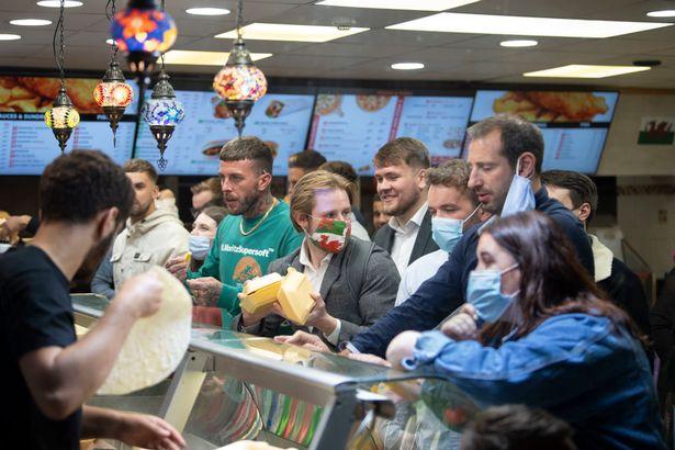 people in kebab shop