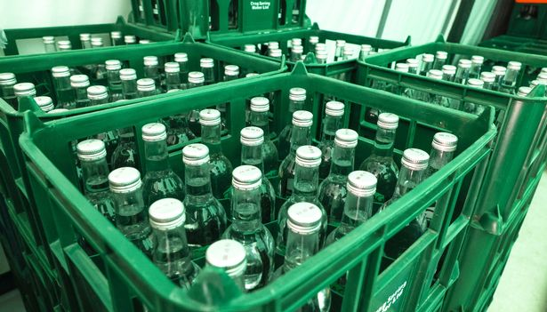 There is enough water flowing through Binder's spring to fill more than a million bottles a day