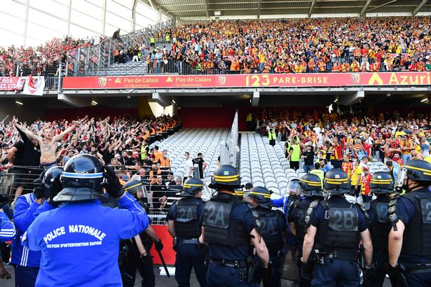 Altercation between fans of Lille and fans of Lens during the Ligue 1 Uber Eats match between Lens and Lille at Stade Bollaert-Delelis on September 18, 2021 in Lens, France.
