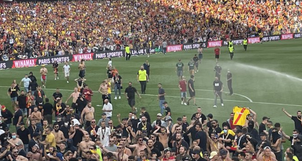 Lens supporters staged a half-time pitch invasion during the visit of Lille