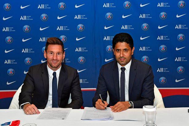Lionel Messi signs his 2 year contract with Paris Saint-Germain President Nasser Al Khelaifi on August 10, 2021 in Paris, France