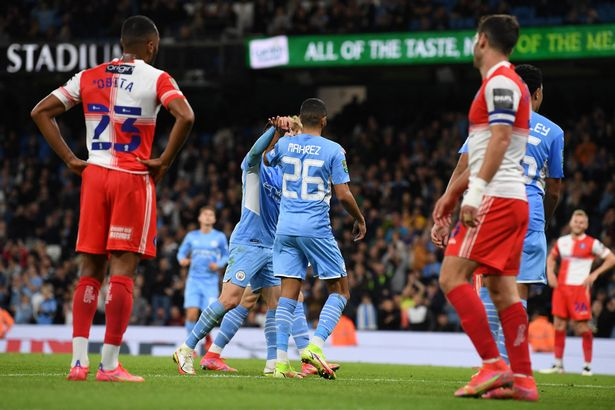 Manchester City's Algerian midfielder Riyad Mahrez (C) celebrates scoring his team's fifth goal during the English League Cup third round football match between Manchester City and Wycombe Wanderers at the Etihad stadium in Manchester, northwest England on September 21, 2021.