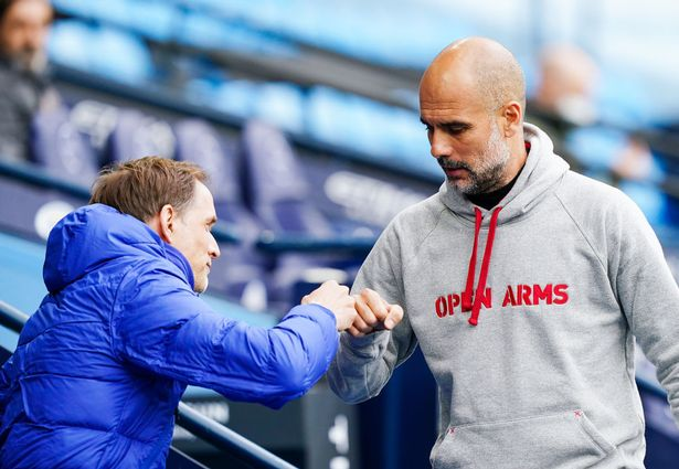 Pep Guardiola, manager of Manchester City fist bumps with Thomas Tuchel, manager of Chelsea during the Premier League match between Manchester City and Chelsea at Etihad Stadium on May 08, 2021 in Manchester, England.