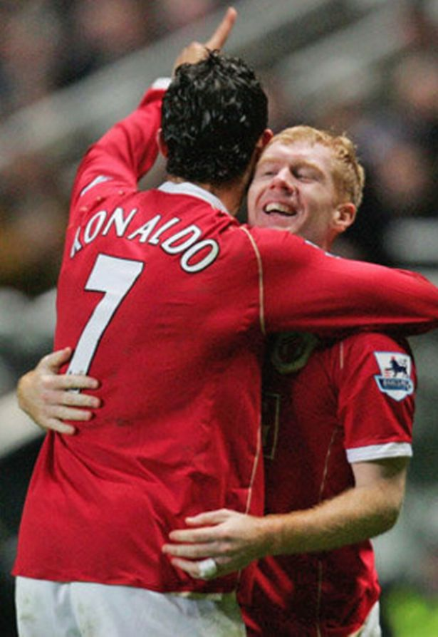 Cristiano Ronaldo and Paul Scholes hug while playing for Manchester United