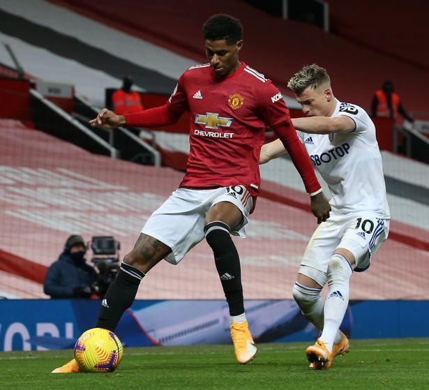 Marcus Rashford shields the ball