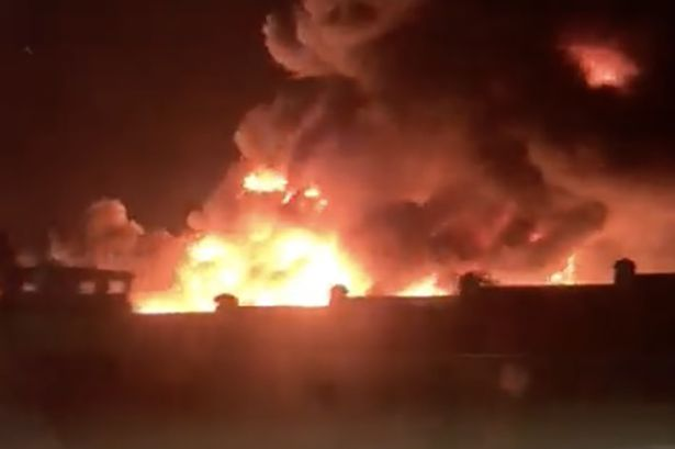 Massive fire near Liverpool docks 'spreading to buildings' as 14 fire engines deployed