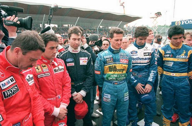 Michael Schumacher and others observed a minute of silence to commemorate the first anniversary of the death of fellow drivers Ayrton Senna of Brazil and Roland Ratzenberger of Austria