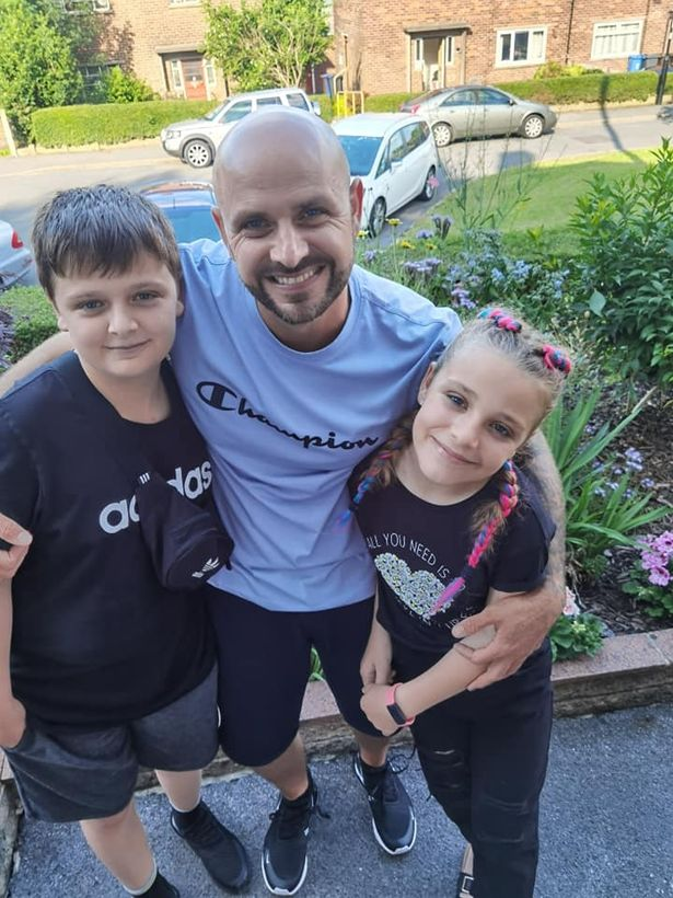 John (left) and Lacey (right) with their dad, Jason Bennett
