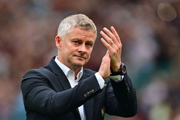 Manchester United's Norwegian manager Ole Gunnar Solskjaer applauds the fans following the English Premier League football match between Manchester United and Aston Villa at Old Trafford in Manchester, north west England, on September 25, 2021.