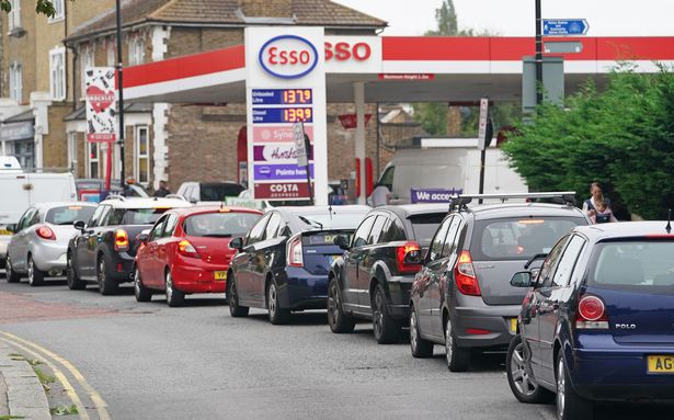 Motorists queue for petrol at an Esso petrol station in Brockley, South London.