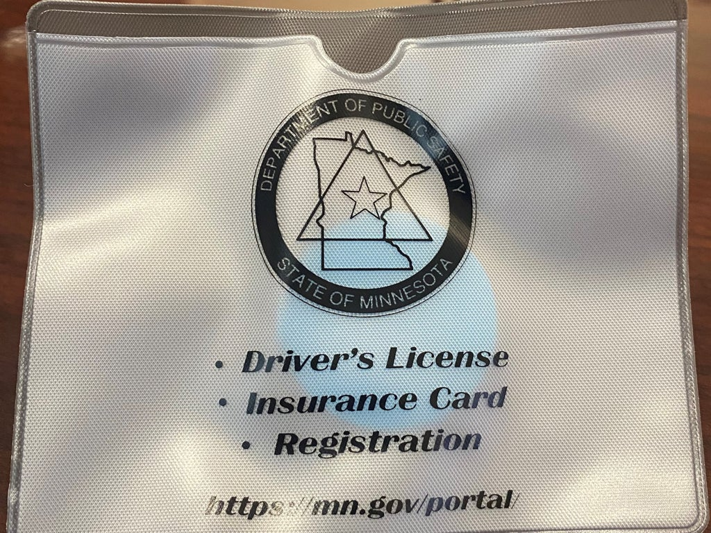 Police-promoted 'Not-Reaching' driving document pouches branded 'don't murder me' bags online