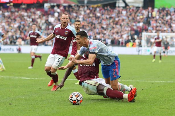 Kurt Zouma of West Ham tackles Cristiano Ronaldo of Man Utd in the box during the Premier League match between West Ham United and Manchester United at London Stadium on September 19, 2021 in London, England.