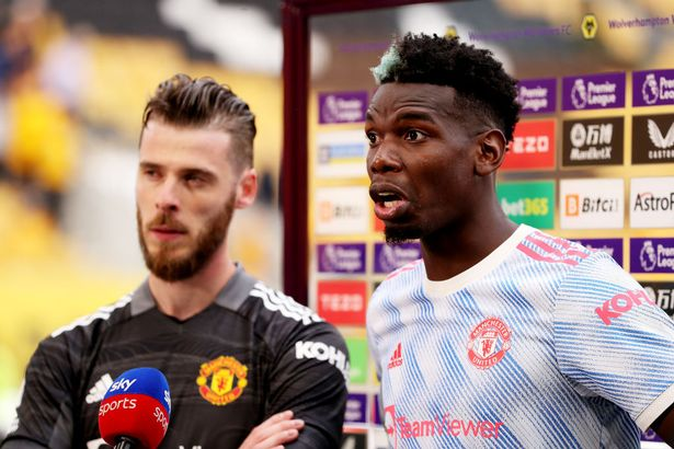 David de Gea (L) and Paul Pogba of Manchester United are interviewed following the Premier League match between Wolverhampton Wanderers and Manchester United at Molineux on August 29, 2021 in Wolverhampton, England. (
