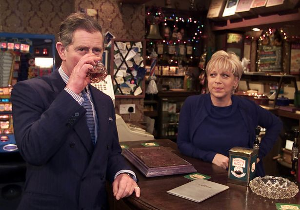 Prince Charles, Prince of Wales enjoys a scotch with Coronation Street land lady Natalie Barnes, played by Denise Welch, in 2009