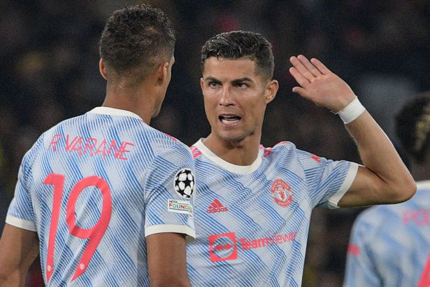 Manchester United's Portuguese striker Cristiano Ronaldo (R) speaks with Manchester United's French defender Raphael Varane (L) during the UEFA Champions League Group F football match between Young Boys and Manchester United at Wankdorf stadium in Bern, on September 14, 2021.