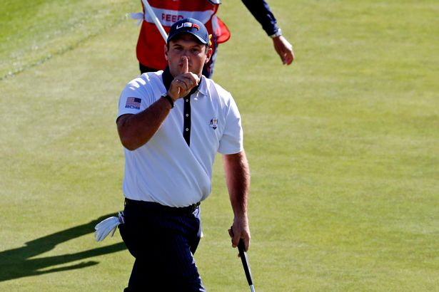 United States golfer Patrick Reed reacts to his putt on the ninth green during the Ryder Cup Saturday Morning matches, 2018