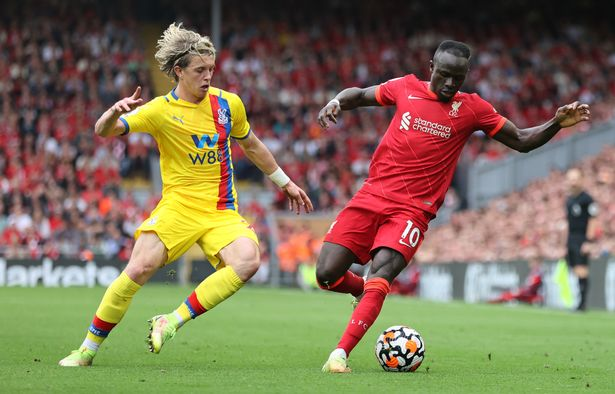 Sadio Mane of Liverpool is challenged by Conor Gallagher of Crystal Palace during the Premier League match between Liverpool and Crystal Palace at Anfield on September 18, 2021 in Liverpool, England.