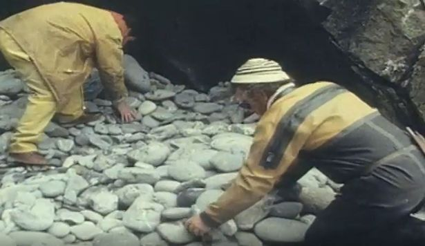 Officials remove stones after discovering the bunker