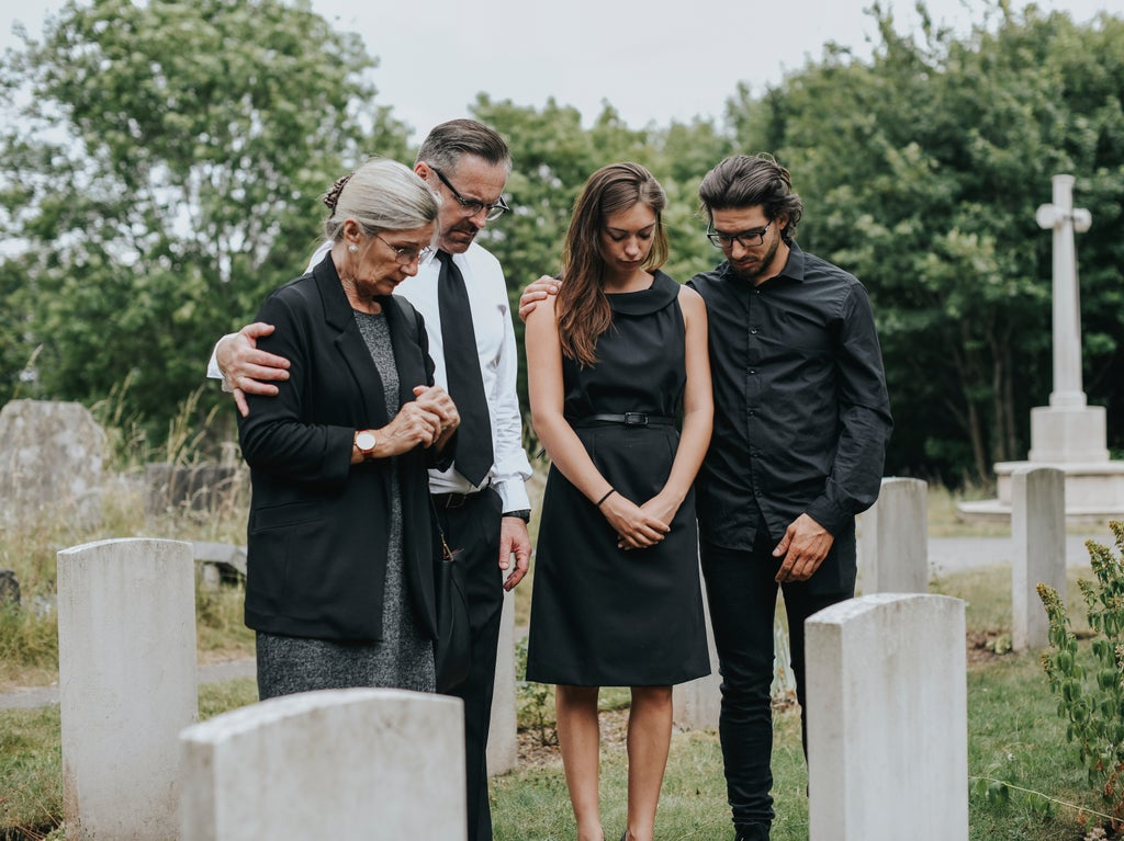 Son defends mother who had 'adulterer' carved into her cheating husband's gravestone