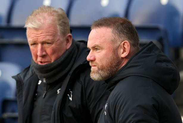 Wayne Rooney, Manager of Derby County talks to Technical Director Steve McClaren prior to the Sky Bet Championship match between Preston North End and Derby County at Deepdale on April 20, 2021 in Preston, England.