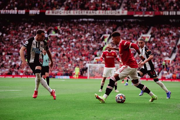 Jadon Sancho of Manchester United in action during the Premier League match between Manchester United and Newcastle United at Old Trafford on September 11, 2021 in Manchester, England.
