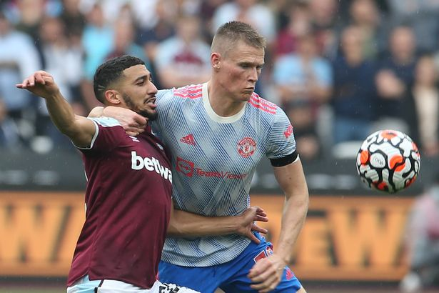 Scott McTominay fights for the ball at the London Stadium