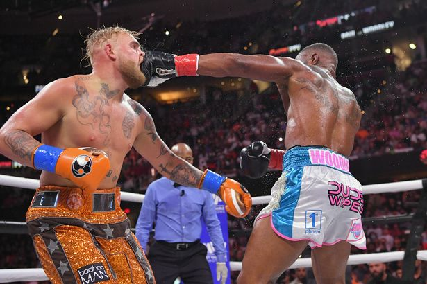 Tyron Woodley punches Jake Paul in their cruiserweight bout during a Showtime pay-per-view event at Rocket Morgage Fieldhouse on August 29, 2021 in Cleveland, Ohi