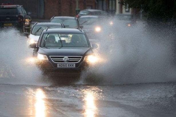 cars driving through deep water