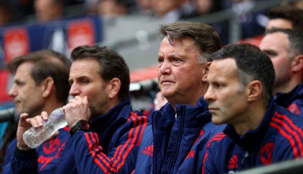 Louis van Gaal alongside assistants Albert Stuivenberg and Ryan Giggs