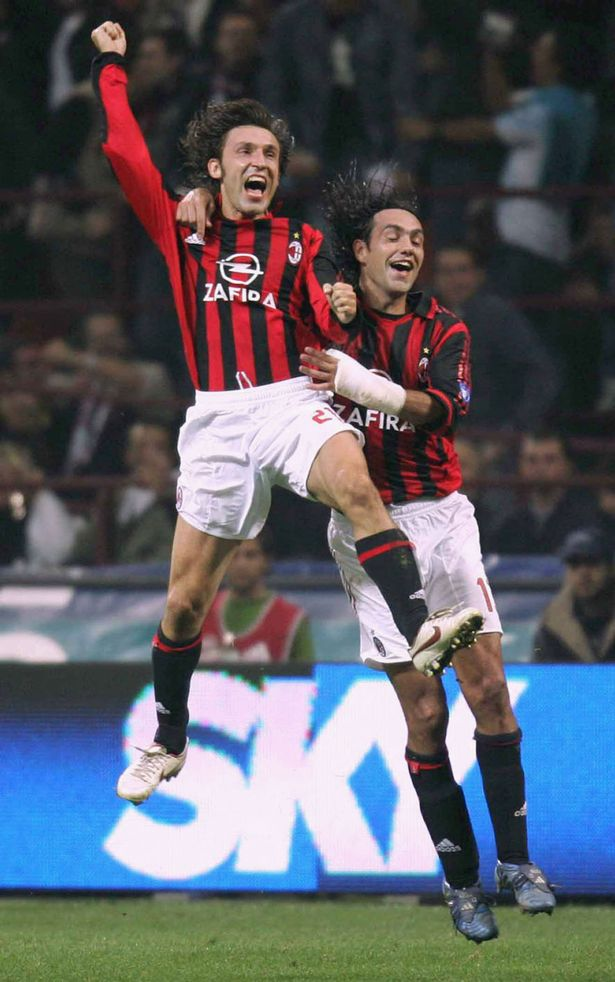 Andrea Pirlo and Alessandro Nesta of AC Milan in action during the Serie A match between AC Milan and Juventus at the Giuseppe Meazza, San Siro Stadium