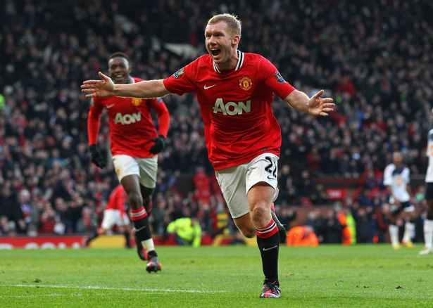Paul Scholes of Manchester United celebrates after scoring the opening goal during the Barclays Premier League match between Manchester United and Bolton Wanderers at Old Trafford