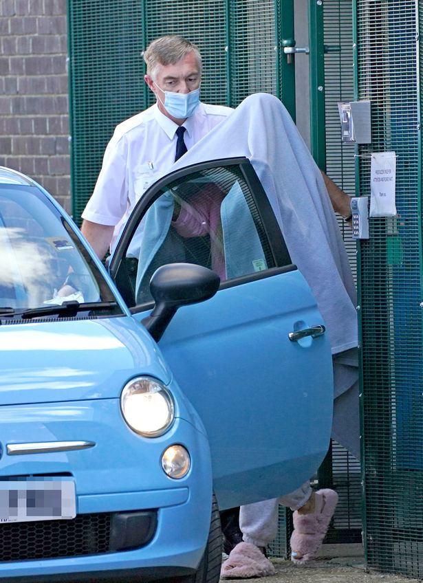Katie Price, covered with a blanket, leaves Crawley Magistrates' Court, West Sussex, where she pleaded guilty to a slew of offences following a crash near her home in Sussex