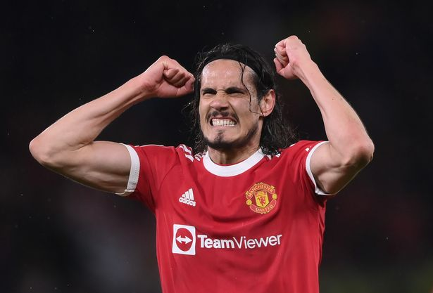 Edinson Cavani of Manchester United celebrates their side's victory after the UEFA Champions League group F match between Manchester United and Villarreal CF at Old Trafford