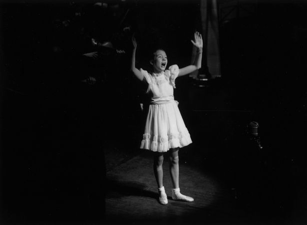 1st November 1948: Julie Andrews as a child singer, performing on stage at the Palladium during a Royal Command Performance.