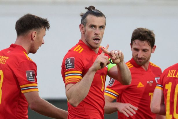Wales' forward Gareth Bale (C) celebrates with teammates after scoring the team's third goal during the FIFA World Cup Qatar 2022 qualification football match between Belarus and Wales