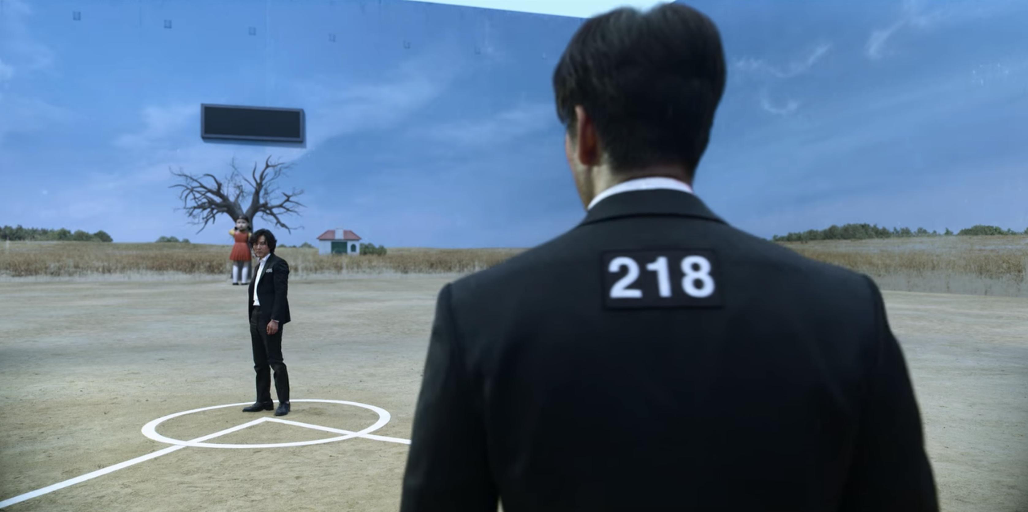 Lee Jung-jae as Seong Gi-hun and Park Hae-soo as Cho Sang-woo in Squid Game